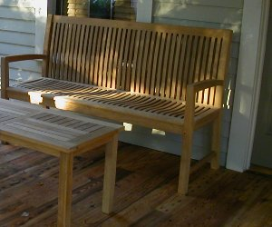 Teak Bench And Coffee Table On Front Porch