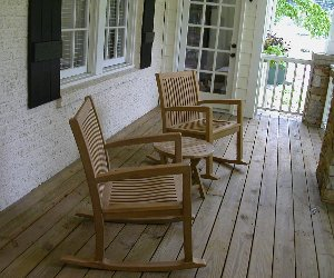 Teak Rocking Chairs On The Porch