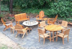 teak furniture around the fire pit