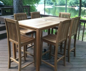 Teak Bar Table And Stools On Outdoor Patio
