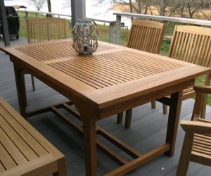 rectangular teak extension table and chairs closed