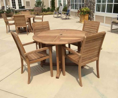 round teak table and stacking chairs
