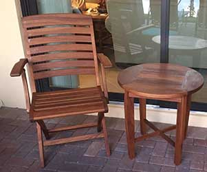 Freshly applied teak oil on teak chair and table
